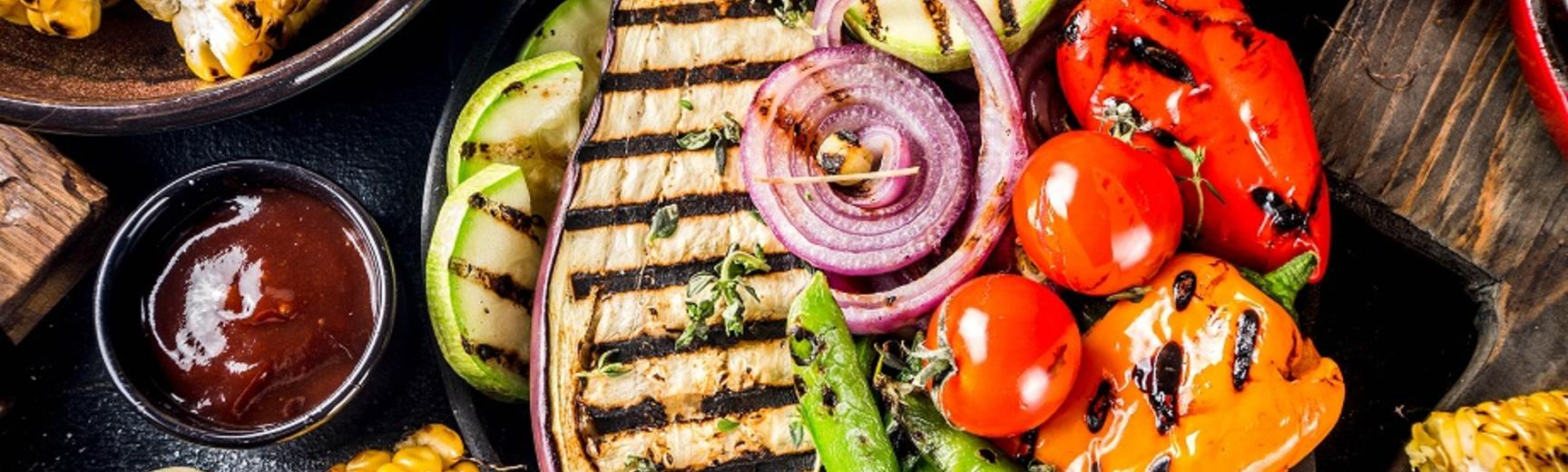 Assortment of colourful grilled and barbecued vegetables on a table