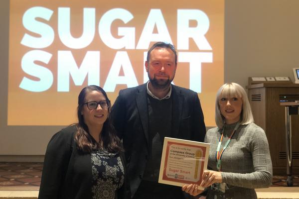 compass team accepts the sugar smart golden teaspoon award