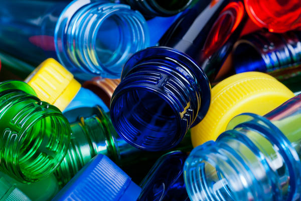 Photo of a pile of plastic bottles of assorted colours